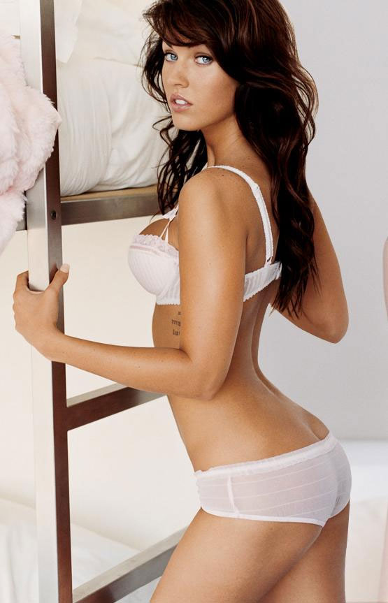 Smoking hot Megan Fox in white bra and panties crwawling into bed